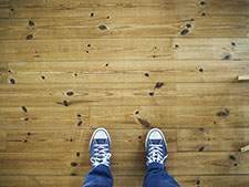 birds eye view of someone standing on a wooden floor